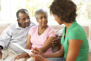 caregiver having evaluation on elderly couple