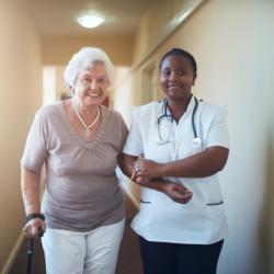 nurse and elderly patient walking