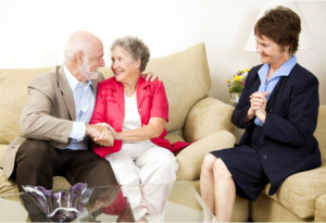 elderly couple and a hospice representative