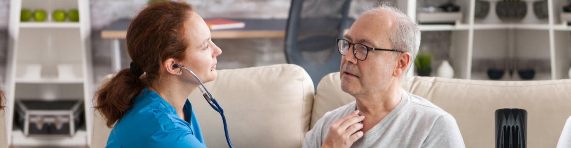 skilled nurse checking senior mans health