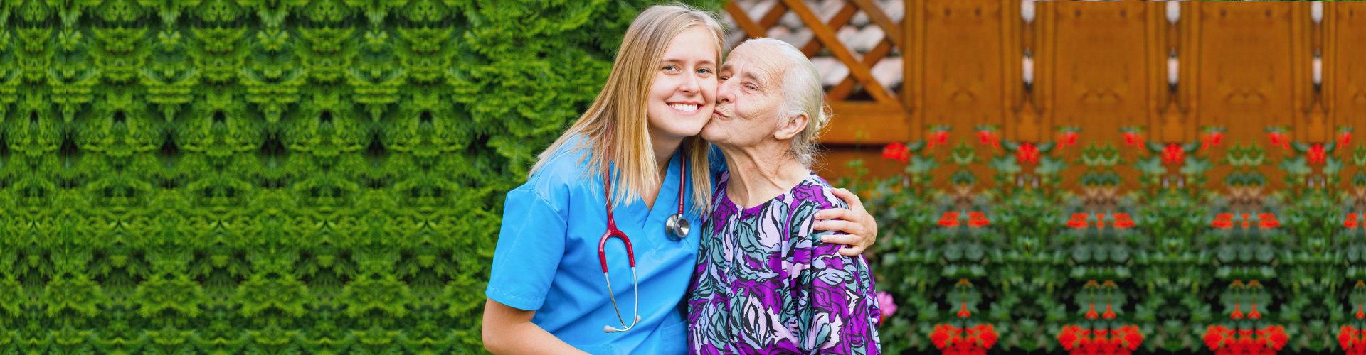senior woman kissing her personal nurse